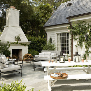 Example of a classic patio design in Los Angeles with a fire pit