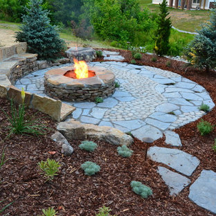 Photo of a medium sized rustic back patio in Richmond with a fire feature, concrete paving and no cover.