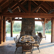 Rustic Patio by RLake Construction