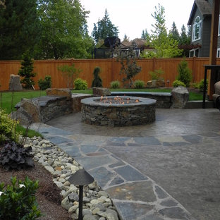 Mid-sized trendy backyard stamped concrete patio photo in Seattle with a fire pit
