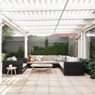 Inspiration for a contemporary backyard patio in Perth with concrete pavers and a pergola.