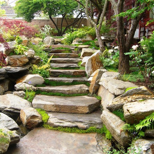 Photo of a small asian backyard patio in San Luis Obispo with a water feature and natural stone pavers.