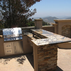 mediterranean patio by Z-man Construction