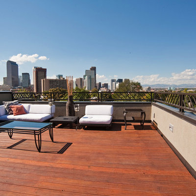Mid-sized trendy patio photo in Denver with decking and no cover