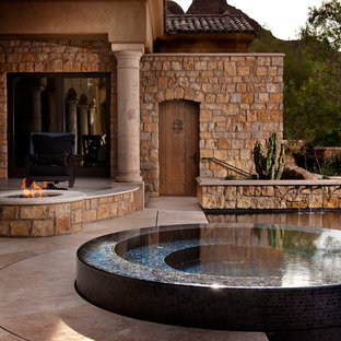 Trendy patio photo in Phoenix with a fire pit