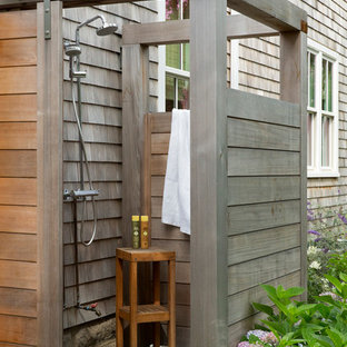 Small coastal backyard tile outdoor patio shower photo in Boston with no cover
