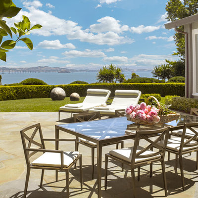 Inspiration for a large timeless backyard stone patio remodel in San Francisco with no cover