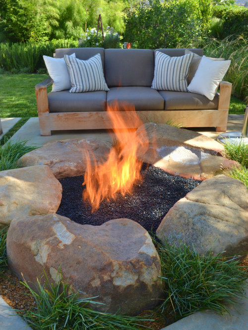 trendy backyard patio photo in san luis obispo with a fire feature