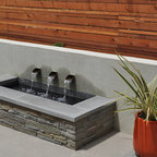 Fountain At Night With Stone Retaining Wall Modern