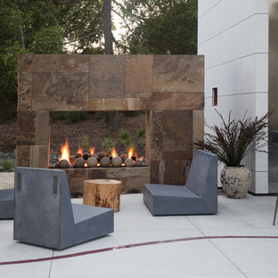Inspiration for a large contemporary backyard concrete patio remodel in San Francisco with a fireplace