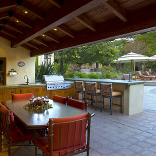 Inspiration for a mediterranean patio in San Francisco with an outdoor kitchen.