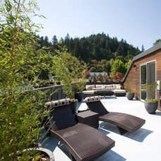 Rustic Patio by Valeant Architecture LLC