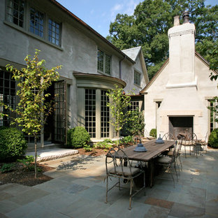 Elegant patio photo in Charlotte with a fire pit