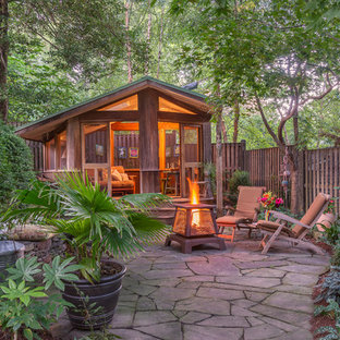 Mid-sized mountain style backyard stone patio photo in DC Metro with a fire pit and no cover