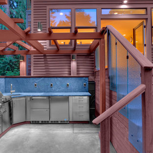 Example of a trendy backyard patio kitchen design in Chicago with a pergola