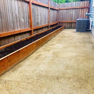 Immagine di un patio o portico moderno di medie dimensioni e nel cortile laterale con graniglia di granito e nessuna copertura