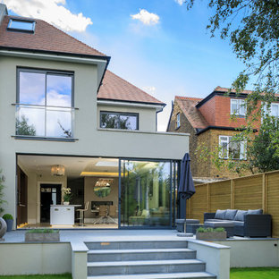 Design ideas for a medium sized contemporary back patio in London with concrete paving and no cover.