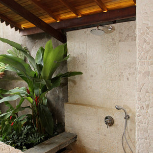 Photo of a tropical patio with an outdoor shower.