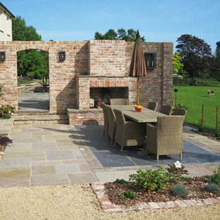 This is an example of a classic back patio in Sussex with no cover and natural stone paving.