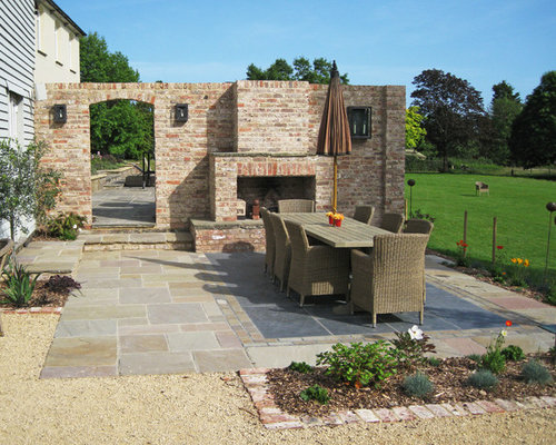 Example Of A Cottage Chic Backyard Stone Patio Design In Sussex With A Fire  Pit