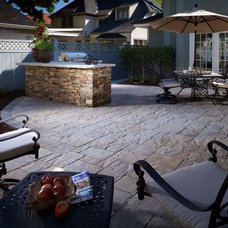 Traditional Patio by Urban Escapes