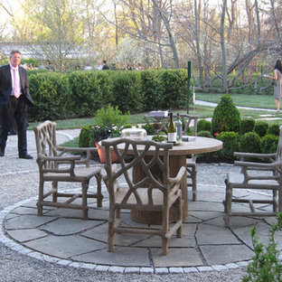 Inspiration for a small classic side patio in New York with natural stone paving and an awning.