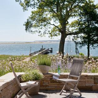 Foto di un patio o portico stile marinaro con nessuna copertura
