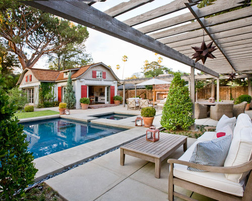 Example Of A Country Backyard Concrete Patio Design In Los Angeles With A  Pergola