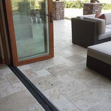 Traditional Patio by Rock Bottom Tile and Stone LLC