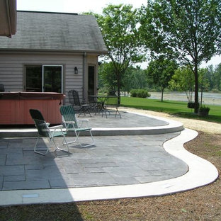 Inspiration for a mid-sized modern backyard stone patio remodel in Milwaukee with no cover