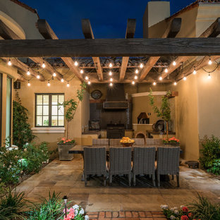 Inspiration for a mid-sized southwestern backyard patio kitchen remodel in Phoenix with a pergola