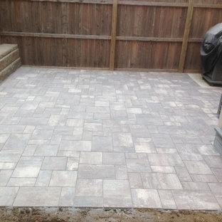 Mid-sized trendy backyard tile patio photo in Philadelphia with no cover