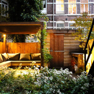 Inspiration for a contemporary patio remodel in Amsterdam with a pergola