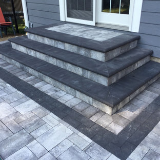 Patio kitchen - large traditional backyard concrete paver patio kitchen idea in New York with no cover