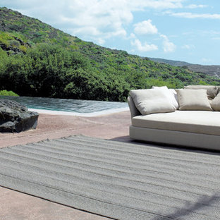 Patio - beach style concrete patio idea in Other with no cover