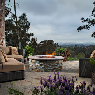Large trendy backyard concrete paver patio photo in San Diego with a fire pit