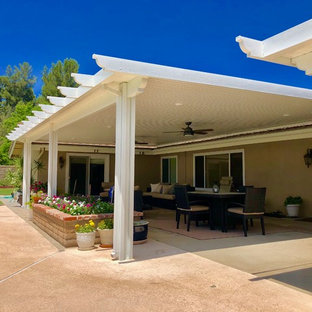 Inspiration for a large traditional back patio in Orange County with stamped concrete and a pergola.