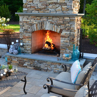 Example of a large arts and crafts backyard concrete paver patio design in Richmond with a fire pit and no cover