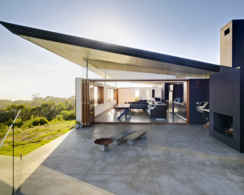 Photo Of A Mid Sized Modern Patio In Sydney With A Fire Feature.