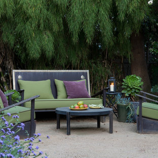 This is an example of a small transitional backyard patio in Los Angeles with decomposed granite and no cover.