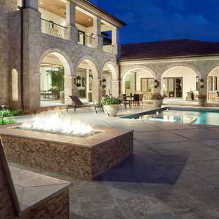 Tuscan patio photo in Austin with a fire pit and no cover