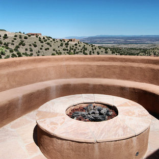 Example of a southwest backyard patio design in Portland with a fire pit and no cover