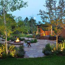 Southwestern Patio by Designscapes Colorado Inc.