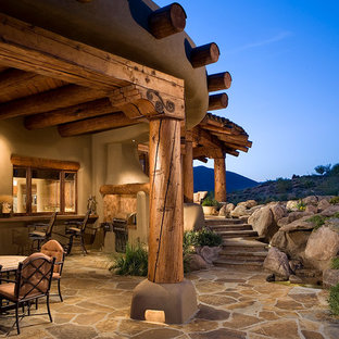 Inspiration for a southwestern stone patio remodel in Phoenix