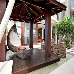 Example of an island style courtyard patio fountain design in Brisbane with a gazebo