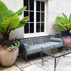 Spa Blue Deep Seating Outdoor Cushions - Customer Photo: Sunbrella Cabaret Bluehaze seat cushions and bolster pillows on an older Brown Jordan couch in a lovely outdoor seating area.