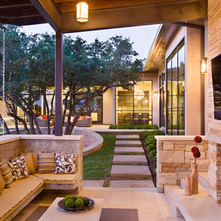 Example of a trendy patio design in Austin with a fire pit and a roof extension