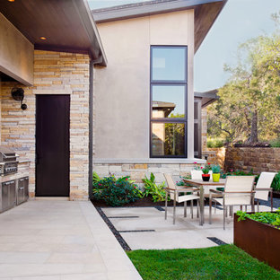 Inspiration for a contemporary backyard patio remodel in Austin