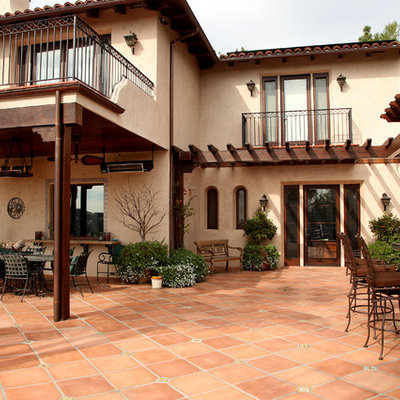 Tuscan patio kitchen photo in Los Angeles