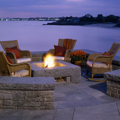 Example of a classic patio design in Boston with a fire pit